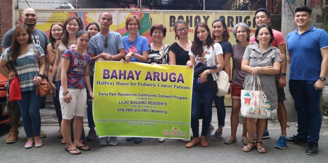Siena Park Residences unit owners and staff pose for a photo after their outreach project at the Bahay Aruga Pediatric Cancer Halfway House in Manila.