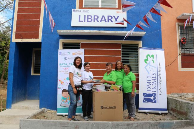 DMCI Homes turns over pre-loved books donated by employees for the public library in Gawad Kalinga's Dreamland community in San Jose del Monte, Bulacan.  Present during the turnover were (L-R) GK Mabuhay Tour Coordinator Rowena Betito, DMCI Homes Corporat