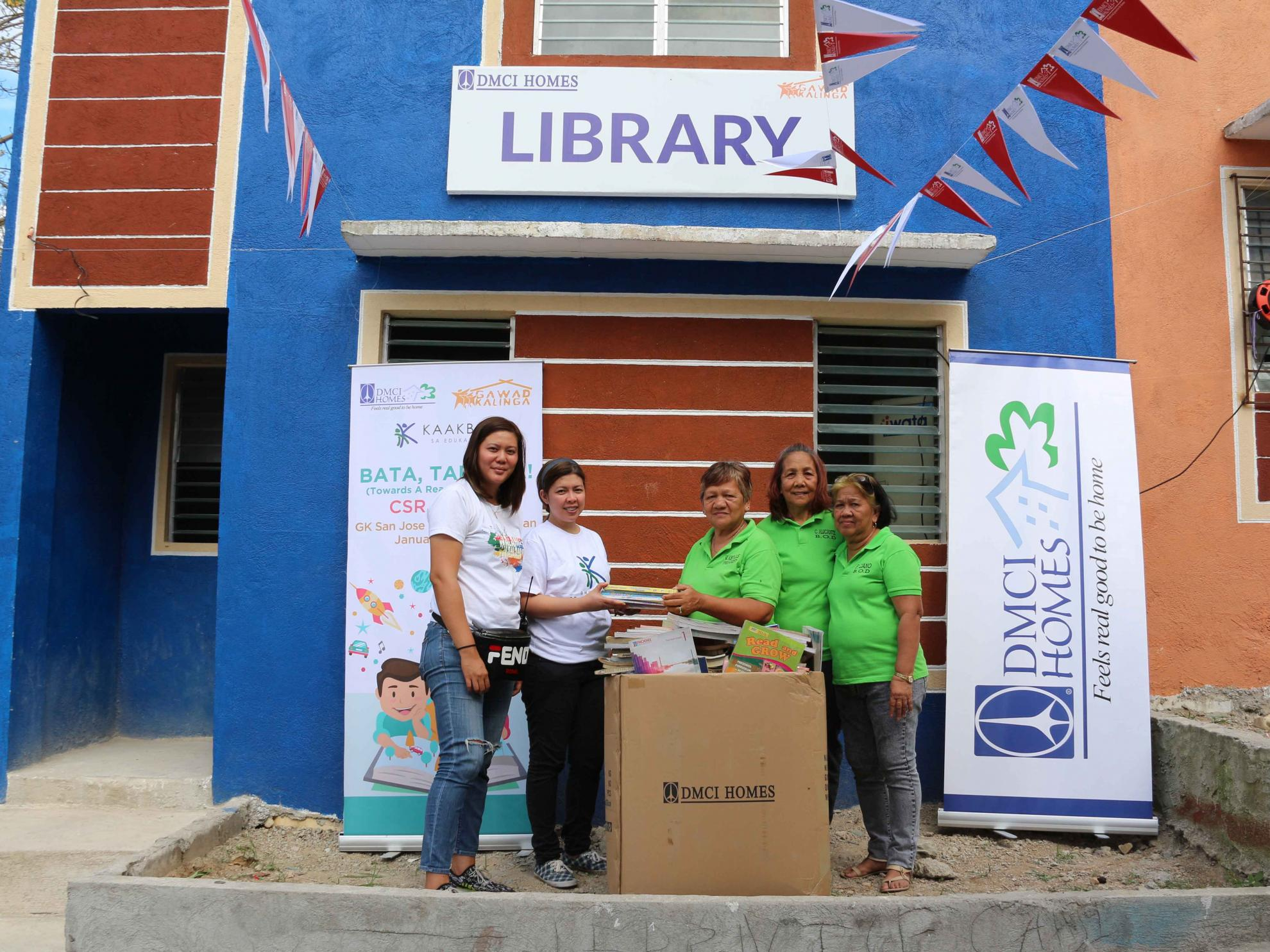 DMCI Homes employees raise books for kids in Bulacan relocation site