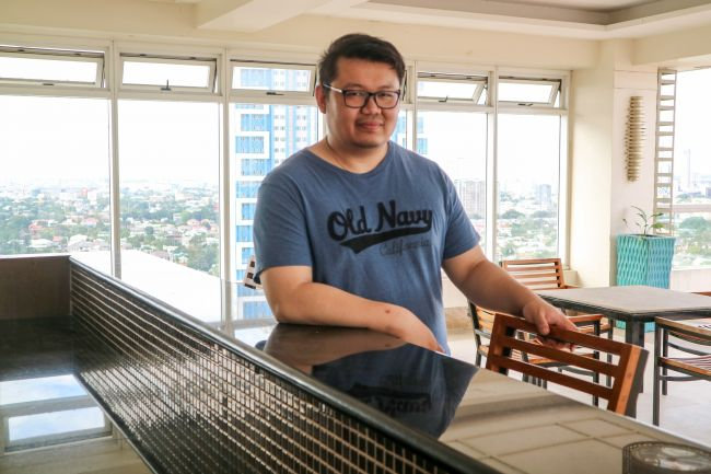 Chris at the Sky Lounge of DMCI Homes' One Castilla Place.