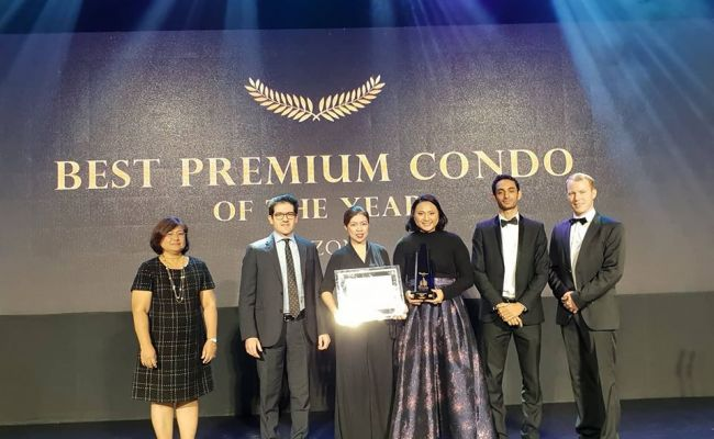 Corporate Communications Manager Josephine Cruz (4th from right) receives the Best Premium Condo of the Year in Luzon (Amenities) for Kai Garden Residences on behalf of DMCI Homes. Verdon Parc, DMCI Homes first project in Davao City, was also Highly Comme