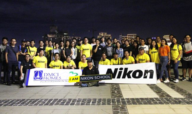 "Participants of ""Urbanscapes"" pose for a souvenir shot with Nikon Philippines brand influencer Cris Magsino at the roof-deck of the Iris Tower in DMCI Homes' Tivoli Garden Residences."