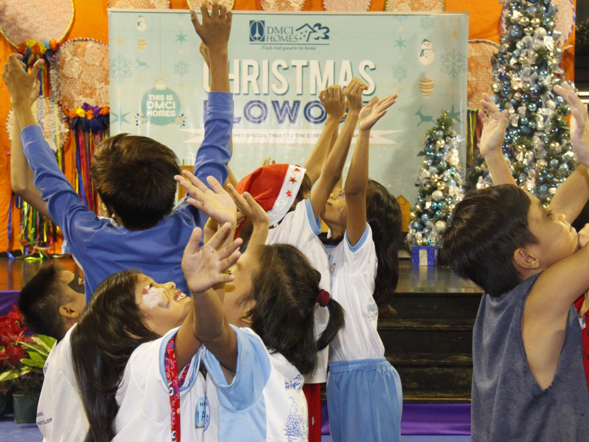 DMCI Homes holds annual gift-giving to underprivileged kids in Makati, Davao